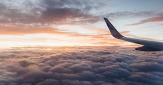 white-airliner-wing-on-top-of-sea-clouds-2007401